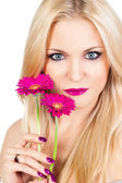 Portrait of a beautiful blonde girl with flower — Stock Photo