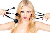 Krásná žena s make-up štětce — Stock fotografie