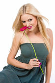 Beautiful blonde girl with flower — Stock Photo