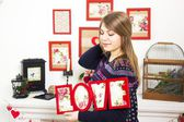 Girl with inscription love — Stock Photo