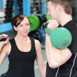 Happy gym workout with personal trainer — Stock Photo