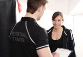 Personal Trainer writing training notes — Stock Photo
