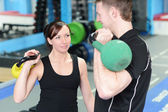 Happy gym workout with personal trainer — Foto Stock