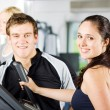 Stock Photo: Personal trainers giving instruction