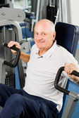Older man exercising at the gym — Stock Photo