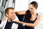 Young couple in the gym — Stock Photo