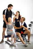 Group of friends in the gym — Stock Photo