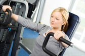 Attractive blond exercising in gym — Stock Photo