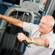 Older man exercising at the gym — Stock Photo #41840521