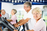Older people exercising in the gym — Foto Stock