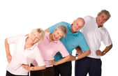 Group of mature people stretching — Stock Photo