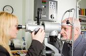 Older man having eye examination — Stock Photo