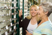 Choosing glasses at the optician — Stock Photo