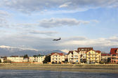 Passenger airplane on landing glideslope over tre river Mzimta in Sochi,Russian Federation — Stock Photo