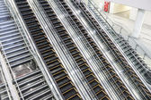 4 moving staircases and usual staircase — Stock Photo