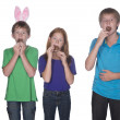 Three young children eating easter eggs — Stock Photo #42053641