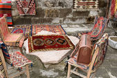 Turkish carpets and leather handbags — Stock Photo