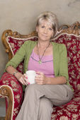 Middle aged woman with cup of coffee — Stock Photo