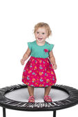 little girl on trampoline  — Stock Photo