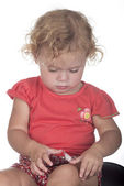 Little girl or toddler with a plaster on her leg — Stock Photo