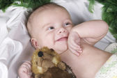 Baby lying with fury toy — Stock Photo