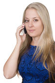 Blond young woman holding a mobile phone — Stock Photo