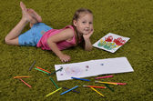 Little girl with markers and sketchbooks — Stock Photo