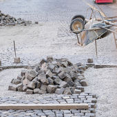Renovation of an old street made of cubic stones — Stock Photo