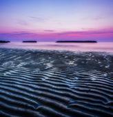 Sunrise by the sea in an italian beach — Stockfoto