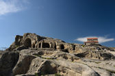 "Uplistsikhe (literally, ""the lord's fortress"") is an ancient rock-hewn town in eastern Georgia. — Foto de Stock"