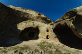 "Uplistsikhe (literally, ""the lord's fortress"") is an ancient rock-hewn town in eastern Georgia. — 图库照片"