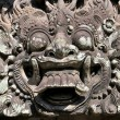 Постер, плакат: Carvings depicting demons gods and Balinese mythological deities can be found throughout the Pura Dalem Agung Padangtegal temple in the Monkey Forest Sanctuary in Ubud Bali