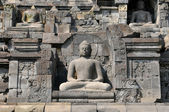 Stupas and Statue of Buddha at Borobudur Temple, Yogjakarta Indonesia. — Stock fotografie