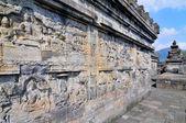 Bas-relief in ancient buddhist temple Borobudur, Yogjakarta Indonesia. — Stock Photo