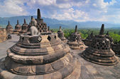 Stupas and Statue of Buddha at Borobudur Temple, Yogjakarta Indonesia. — Stockfoto