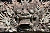 Carvings depicting demons, gods and Balinese mythological deities can be found throughout the Pura Dalem Agung Padangtegal temple in the Monkey Forest Sanctuary in Ubud, Bali. — Stock Photo