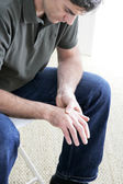 MAN WITH PAINFUL HAND — Stock Photo
