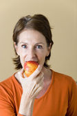ELDERLY PERSON EATING FRUIT — Stock Photo