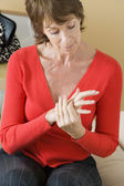 ELDERLY PERS. WITH PAINFUL HAND — Stock Photo