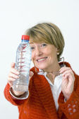 ELDERLY PERSON WITH COLD DRINK — Stock fotografie