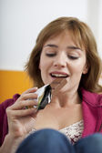 WOMAN SNACKING — Stock Photo