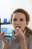 WOMAN TAKING MEDICATION — Stock Photo