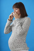 PREGNANT WOMAN WITH NOSE SPRAY — Stock Photo