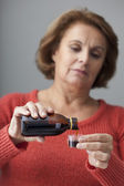 COUGHING TREATMENT ELDERLY PERS. — Stock Photo