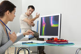 ORTHOPEDICS CONSULTATION MAN — Stock Photo