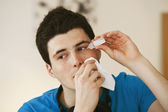 ADOLESCENT USING EYE LOTION — Stockfoto