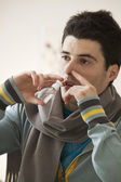 ADOLESCENT USING NOSE SPRAY — Stockfoto