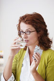 WOMAN TAKING MEDICATION — Stockfoto