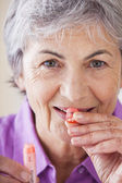 HOMEOPATHY, ELDERLY PERSON — Stockfoto