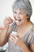 ELDERLY PERSON, DAIRY PRODUCT — Stock Photo